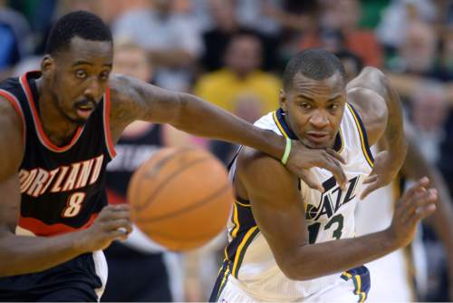 Steve Griffin  |  The Salt Lake Tribune  Utah Jazz guard Elijah Millsap (13), right, and Portland Trail Blazers forward Al-Farouq Aminu (8) chase the ball during the Utah Jazz versus the Portland Trailblazers preseason NBA basketball game at EnergySolutions Arena in Salt Lake City, Monday, October 12, 2015.
