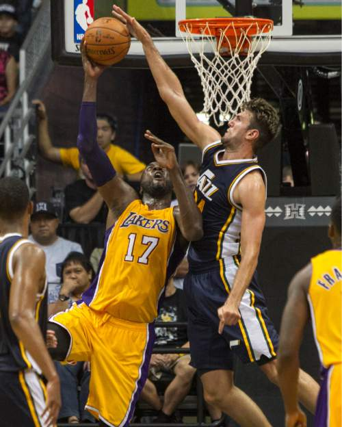 Utah Jazz center Jeff Withey (24), right, blocks a shot from Los Angeles Lakers center Roy Hibbert (17) during the second half of an NBA preseason basketball game, Tuesday, Oct. 6, 2015, in Honolulu.  The Jazz defeated the Lakers 117-114.  (AP Photo/Marco Garcia)
