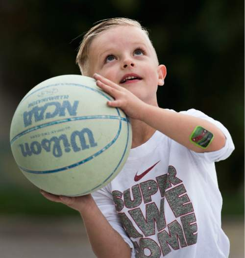 Steve Griffin  |  The Salt Lake Tribune  J.P. Gibson plays basketball on his home court in Layton, Utah Wednesday, September 30, 2015.   Gibson captured the hearts of many when the 5-year-old got the chance to participate in a Utah Jazz scrimmage last season. A year later, he is cancer free.