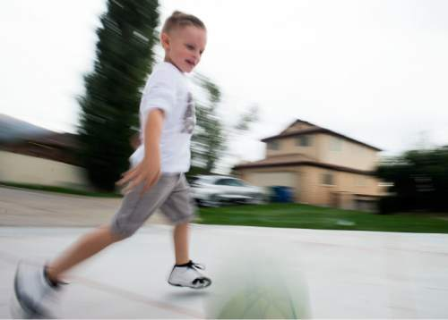 Steve Griffin  |  The Salt Lake Tribune  J.P. Gibson dribbles on his home court in Layton, Utah Wednesday, September 30, 2015.   Gibson captured the hearts of many when the 5-year-old got the chance to participate in a Utah Jazz scrimmage last season. A year later, he is cancer free.
