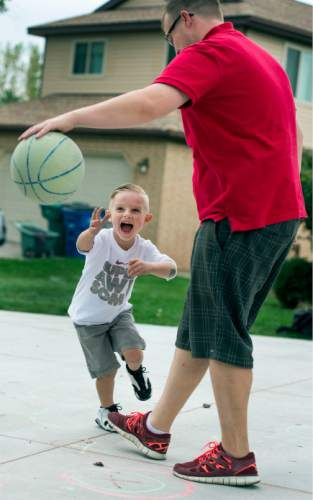 Steve Griffin  |  The Salt Lake Tribune  J.P. Gibson goes for a steal as he plays with his father, Josh, on their home court in Layton, Utah Wednesday, September 30, 2015.   Gibson captured the hearts of many when the 5-year-old got the chance to participate in a Utah Jazz scrimmage last season. A year later, he is cancer free.