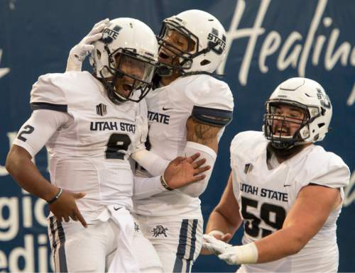 Rick Egan     The Salt Lake Tribune  Utah State quarterback Kent Myers (2) is joined by wide receiver Brandon Swindall (11), Aggies center Austin Stephens (59), after Myers ran for a touchdown, in college football action, Utah State vs Colorado State at Maverik Stadium in Logan, Saturday, October 3, 2015.