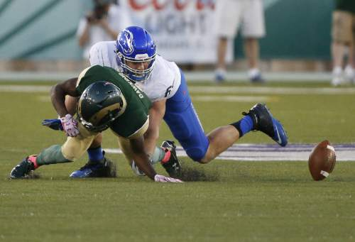 Boise State defensive tackle Tyler Horn (69) brings down Colorado State running back Dalyn Dawkins (1) in the first half of an NCAA college football game Saturday, Oct. 10, 2015 in Fort Collins, Colo. (AP Photo/Brennan Linsley)