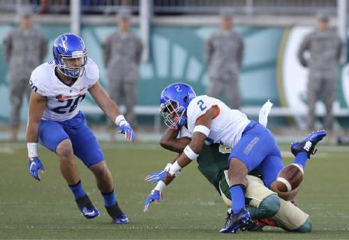 Boise State cornerback Jonathan Moxey (2) collides with Colorado State wide receiver Xavier Williams after blocking a catch in the first half of an NCAA college football game Saturday, Oct. 10, 2015 in Fort Collins, Colo. (AP Photo/Brennan Linsley)