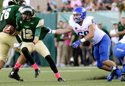 Colorado State quarterback Coleman Key spins away from Boise State defensive tackle Tyler Horn during an NCAA college football game in Ft. Collins, Colo., on Saturday, Oct. 10, 2015. (Joe Jaszewski/Idaho Statesman via AP)  LOCAL TELEVISION OUT (KTVB 7); MANDATORY CREDIT