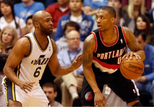 Rick Egan  | The Salt Lake Tribune   Portland Trail Blazers point guard Damian Lillard (0) dribbles the ball, as Utah Jazz point guard Jamaal Tinsley (6) defends, in NBA action, as the Jazz faced the Portland Trailblazers, at EnergySolutions Arena, Monday, April 1, 2013.