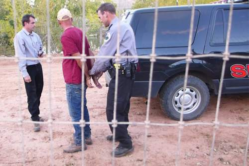|  Courtesy Sam Brower  Andrew Chatwin being placed under arrest Oct. 13, 2015.