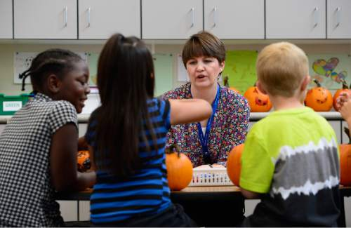 Scott Sommerdorf   |  The Salt Lake Tribune Plymouth Elementary teacher Tara Fredley works with students who were decorating pumpkins in her 2nd grade class, Thursday, October 1, 2015. Fredley is one of the most experienced teachers at the school.