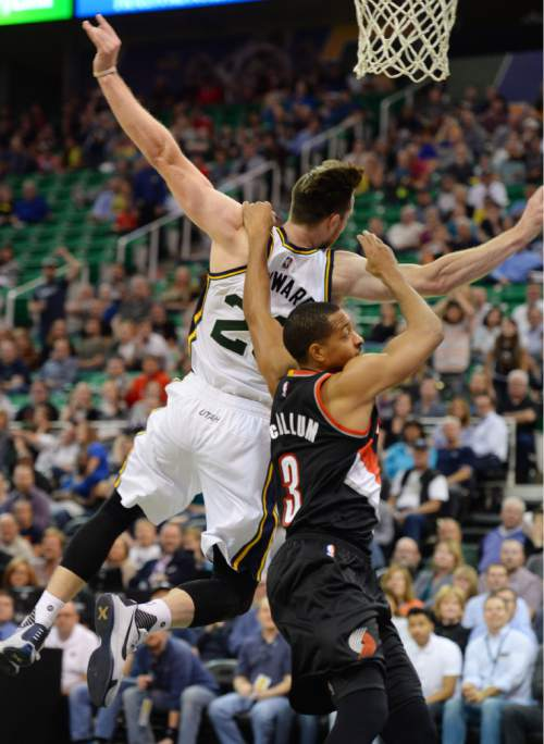 Steve Griffin  |  The Salt Lake Tribune  Utah Jazz guard Gordon Hayward (20) gets pulled down from behind by Portland Trail Blazers guard C.J. McCollum (3) late in the second half of the Utah Jazz versus the Portland Trailblazers preseason NBA basketball game at EnergySolutions Arena in Salt Lake City, Monday, October 12, 2015. McCollum was called for a flagrant foul and ejected from the game.