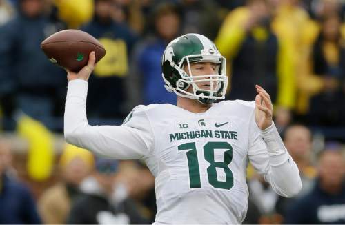Michigan State quarterback Connor Cook (18) throws a pass during the first half of an NCAA college football game against Michigan, Saturday, Oct. 17, 2015, in Ann Arbor, Mich. (AP Photo/Carlos Osorio)