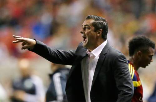Real Salt Lake coach Jeff Cassar shouts to his team during the second half during an MLS soccer match against the Portland Timbers on Wednesday, Oct. 14, 2015, in Sandy, Utah. The Timbers won 1-0. (AP Photo/Rick Bowmer)