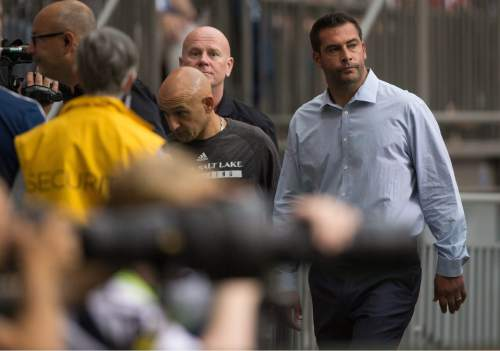 Real Salt Lake head coach Jeff Cassar, right, leaves the field after being ejected by referee Chris Penso during the first half of an MLS soccer game against the Vancouver Whitecaps in Vancouver, British Columbia, Saturday, Aug. 8, 2015. (Darryl Dyck/The Canadian Press via AP) MANDATORY CREDIT