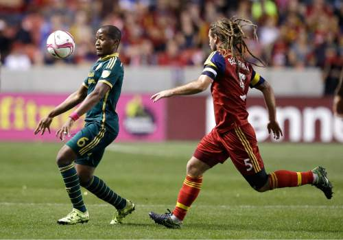 Portland Timbers' Darlington Nagbe (6) controls the ball as Real Salt Lake's Kyle Beckerman (5) defends in the first half during an MLS soccer game Wednesday, Oct. 14, 2015, in Sandy, Utah. (AP Photo/Rick Bowmer)