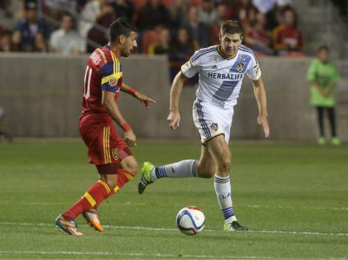 Real Salt Lake's Javier Morales, left, looks to pass past L.A. Galaxy's Steven Gerrard during the first half of an MLS soccer match on Saturday, Sept. 19, 2015, in Sandy, Utah. Real Salt Lake won 3-0. (AP Photo/Kim Raff)