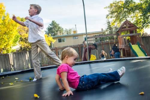 Chris Detrick     The Salt Lake Tribune Jacen Nelson, 8, and Sara, 2, play on the trampoline at their home in West Jordan Thursday October 15, 2015.