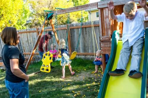 Chris Detrick     The Salt Lake Tribune Tina and Shayne Nelson watch as their kids Jacen, 8, Mara, 8, Sara, 2, and Luke, 11 months, play at their home in West Jordan Thursday October 15, 2015.