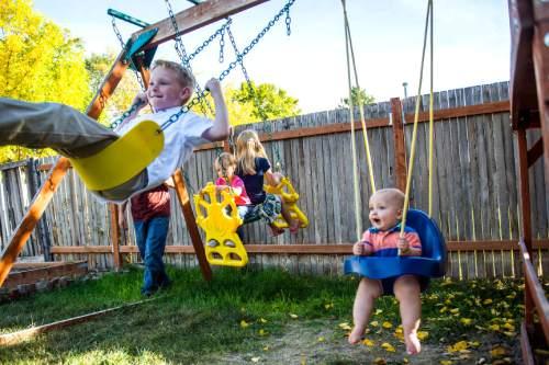 Chris Detrick     The Salt Lake Tribune Shayne Nelson watches as kids Jacen, 8, Mara, 8, Sara, 2, and Luke, 11 months, play at their home in West Jordan Thursday October 15, 2015.