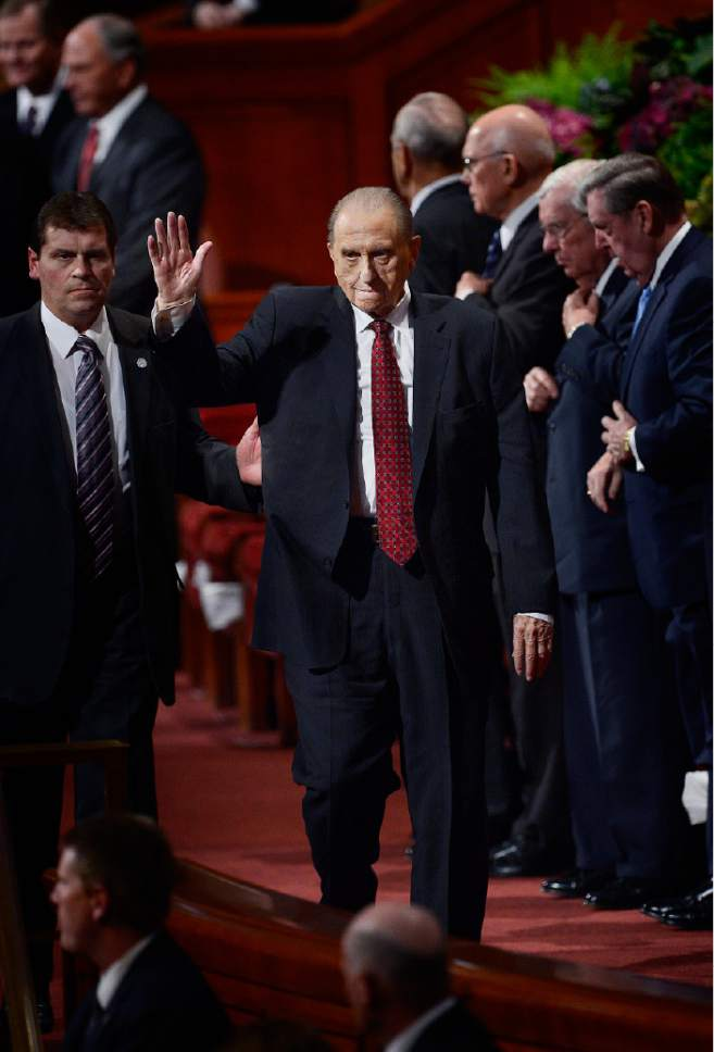 Scott Sommerdorf   |  The Salt Lake Tribune President Thomas S. Monson waves as he leaves the morning session of the 185th Semiannual General Conference, Sunday, October 4, 2015.