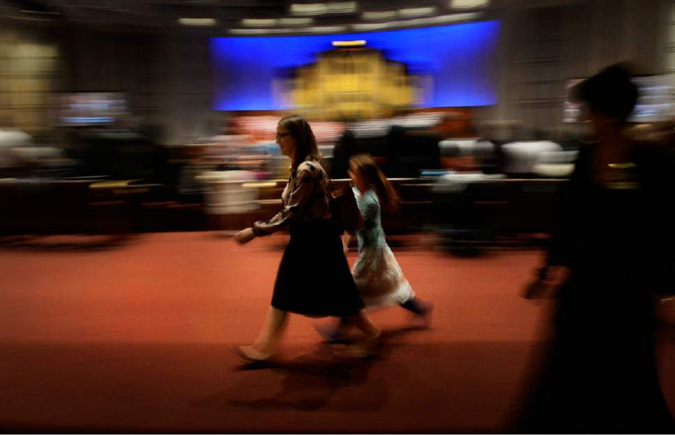 Scott Sommerdorf   |  The Salt Lake Tribune People move to their seats at the afternoon session of the 185th Semiannual General Conference, Sunday, October 4, 2015.