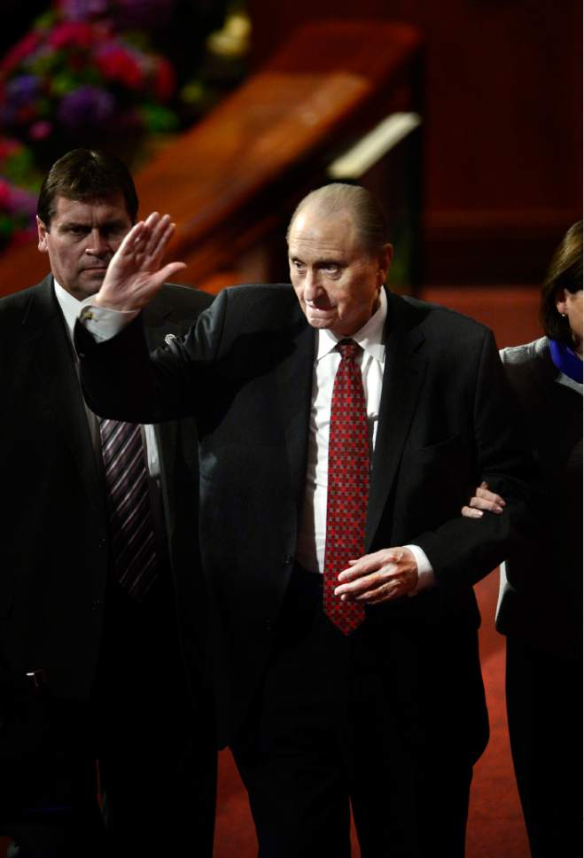 Scott Sommerdorf   |  The Salt Lake Tribune President Thomas S. Monson waves as he leaves the afternoon session of the 185th Semiannual General Conference, Sunday, October 4, 2015.