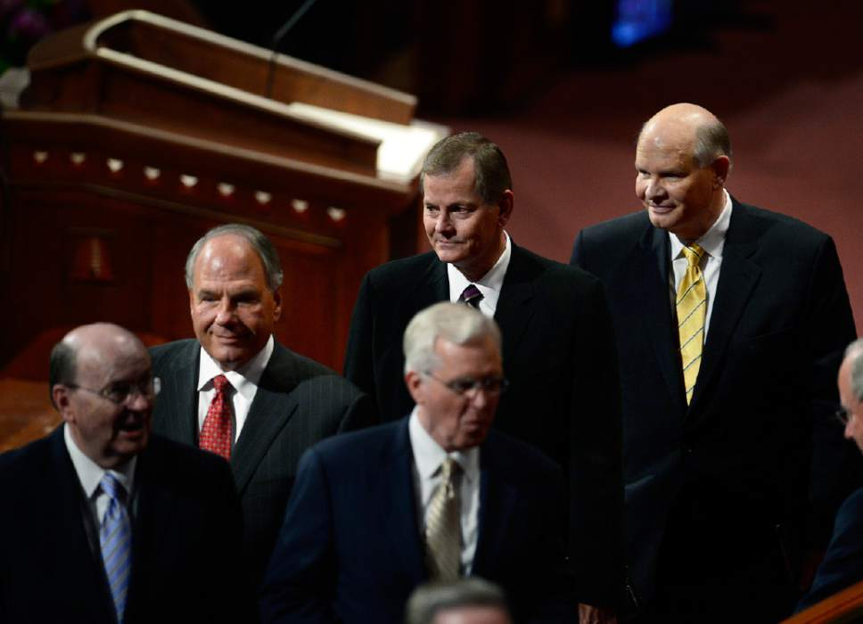 Scott Sommerdorf   |  The Salt Lake Tribune The new members of the Quorum of the Twelve leave at the end of the afternoon session of the 185th Semiannual General Conference, Sunday, October 4, 2015. From left, Elder Ronald A. Rasband, Elder Gary E. Stevenson, center, and Elder Dale G. Renlund, right.