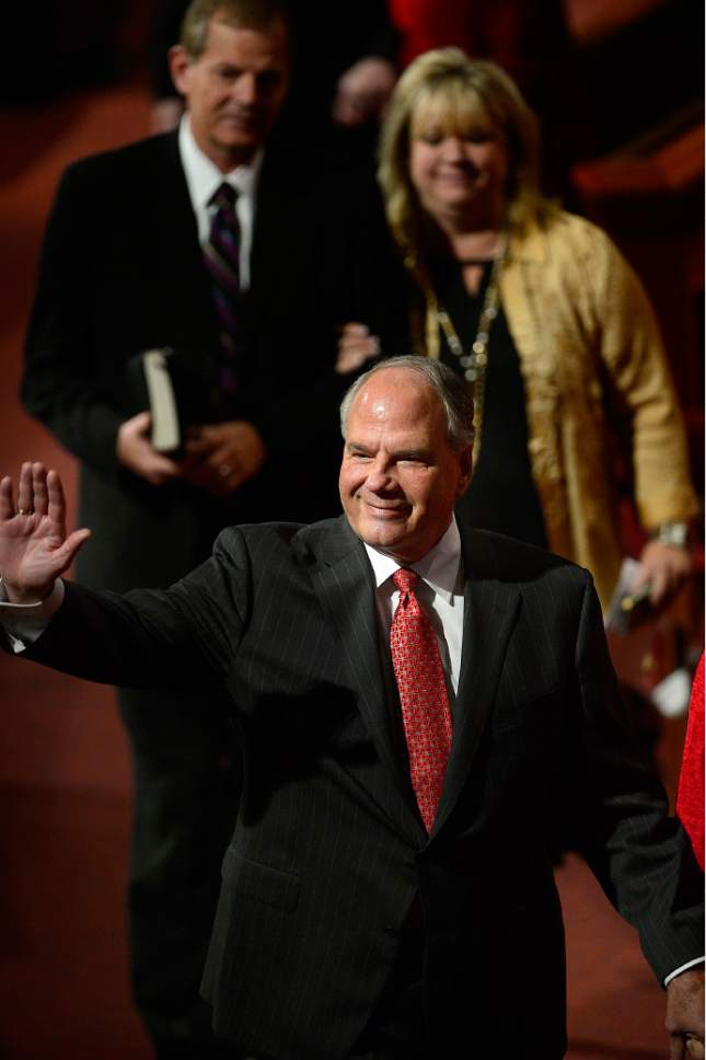 Scott Sommerdorf   |  The Salt Lake Tribune Elder Ronald A. Rasband waves as he leaves the afternoon session of the 185th Semiannual General Conference, Sunday, October 4, 2015.