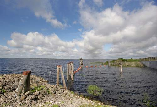 In this Wednesday, Sept. 30, 2015, photo, the Taylor Creek Reservoir is seen in Deseret Ranch, Fla. Over the next six decades, the plan being developed by the Mormon church-owned Deseret Ranch promises to convert the largest undeveloped section of metro Orlando into more than a dozen bustling neighborhoods. (AP Photo/John Raoux)