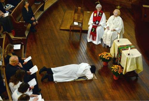 Steve Griffin  |  The Salt Lake Tribune  Clare Julian Carbone  lies prostrate at the First United Methodist Church in Salt Lake City during her ordination to the priesthood by a group called Association of Roman Catholic Women Priests, Sunday, October 18, 2015.  The Catholic Church does not recognize such ordinations, but the women priest movement  has ordained 220 women since beginning in Germany in 2002.