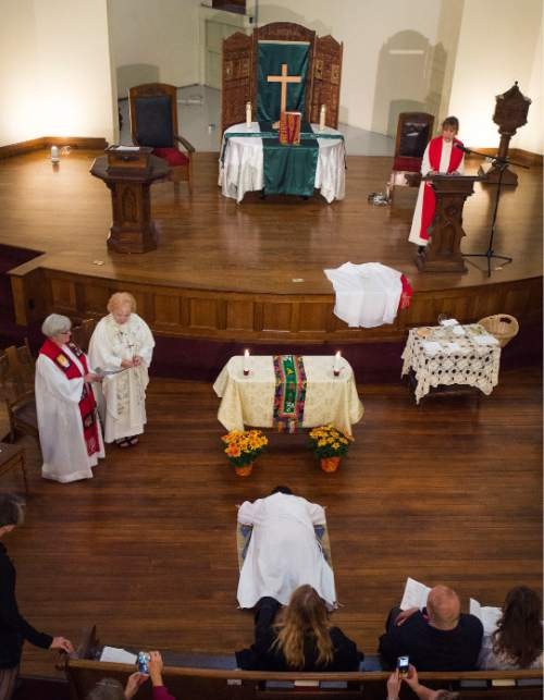 Steve Griffin  |  The Salt Lake Tribune  Clare Julian Carbone  lies prostrate at the First United Methodist Church in Salt Lake City during her ordination to the priesthood by Association of Roman Catholic Women Priests, October 18, 2015.  The Catholic Church does not recognize such ordinations, but the women priest movement has ordained 220 women since beginning in Germany in 2002.