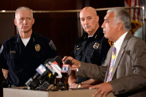 Al Hartmann  |  The Salt Lake Tribune Salt Lake County District Attorney Sim Gill holds a press conference Monday October 19 with Salt Lake City Police Chief Mike Brown, middle, to discuss the findings of the Officer Involved Critical Incident (OICI) review and Salt Lake County Sheriff Jim Winder, left, in the Sept. 23 incident involving  Salt Lake City Police Department Officer Ben Hone who shot and killed a home intruder as he assaulted Salt Lake City residents and sisters Breann and Kayli Lasley.   The review determined the use of deadly force by Hone was legally justified.