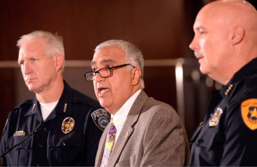 Al Hartmann  |  The Salt Lake Tribune Salt Lake County District Attorney Sim Gill holds a press conference Monday October 19 with Salt Lake City Police Chief Mike Brown, right, to discuss the findings of the Officer Involved Critical Incident (OICI) review and Salt Lake County Sheriff Jim Winder, left, in the Sept. 23 incident involving  Salt Lake City Police Department Officer Ben Hone who shot and killed a home intruder as he assaulted Salt Lake City residents and sisters Breann and Kayli Lasley.   The review determined the use of deadly force by Hone was legally justified.