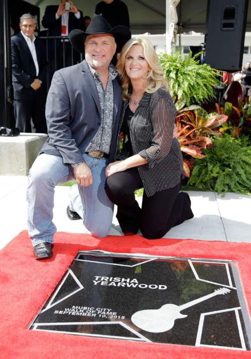 Garth Brooks poses with his wife, Trisha Yearwood, after Yearwood was presented with her star on the Music City Walk of Fame Thursday, Sept. 10, 2015, in Nashville, Tenn. Both Yearwood and Brooks were given stars. (AP Photo/Mark Humphrey)