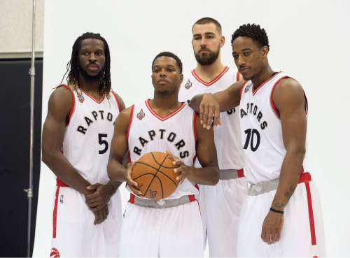 From left, Toronto Raptors' DeMarre Carroll, Kyle Lowry, Jonas Valanciunas, and DeMar DeRozan, pose during the team's NBA basketball media day Monday, Sept. 28, 2015, in Toronto.  (Darren Calabrese/The Canadian Press via AP) MANDATORY CREDIT