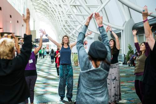 Chris Detrick  |  The Salt Lake Tribune Morgane Scheffer, of France, center, dances with Uniting Flash Mob during the Parliament of the World's Religion at the Salt Palace Convention Center on Saturday.