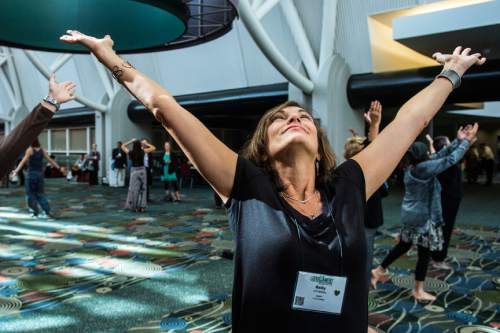 Chris Detrick  |  The Salt Lake Tribune Sally Annabella, of Seattle, dances with Uniting Flash Mob during the Parliament of the World's Religion at the Salt Palace Convention Center Saturday October 17, 2015.