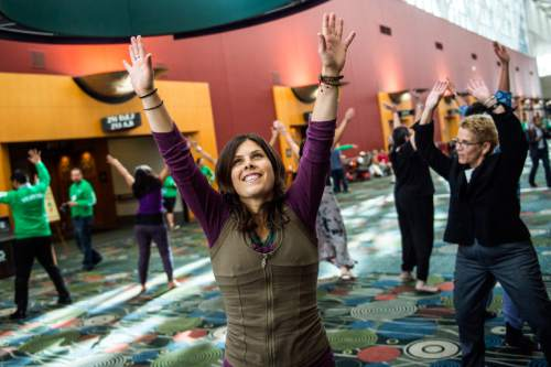 Chris Detrick  |  The Salt Lake Tribune Hilary Lake, of Plainfield, Mass., dances with Uniting Flash Mob during the Parliament of the World's Religion at the Salt Palace Convention Center Saturday October 17, 2015.
