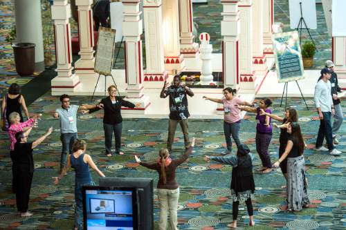 Chris Detrick  |  The Salt Lake Tribune Dancers with Uniting Flash Mob dance during the Parliament of the World's Religion at the Salt Palace Convention Center Saturday October 17, 2015.