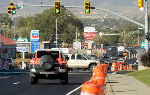 Al Hartmann  |  The Salt Lake Tribune Recently redone and updated stretch of 5300 South from I-15 to Redwood Road is up and running Monday Ocotber 12.  Orange barrels yet to be removed.