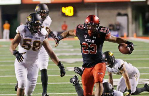 Utah running back Devontae Booker (23) carries the ball as Arizona State linebacker Salamo Fiso (58) looks on in the first half during an NCAA college football game Saturday, Oct. 17, 2015, in Salt Lake City. (AP Photo/Rick Bowmer)
