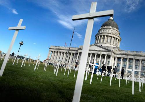 Al Hartmann  |  The Salt Lake Tribune 361 crosses were placed on the front lawn of the Utah State Capitol Thursday Oct. 21 for Alliance for a Better Utah to make a visual point for their press conference.  Today marks 657 days since the Utah Legislature had the first opportunity to grant access to affordable healthcare for thousands of Utahns most in need. Better Utah estimates that as many as 361 Utahns (represented by the rows of crosses) have died because they don't have access to affordable healthcare.