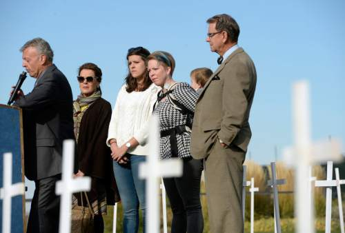 Al Hartmann  |  The Salt Lake Tribune Board members of Alliance for a Better Utah, Jonathan Ruga, left, Diane Stewart, Tillie McInnis, Crystal Otterstrom with 18-month-old son Edwin and David Irvine stand in a field of 361 crosses on the front lawn of the Utah State Capitol Thursday Oct. 21 to speak at a press conference.  Today marks 657 days since the Utah Legislature had the first opportunity to grant access to affordable healthcare for thousands of Utahns most in need. Better Utah estimates that as many as 361 Utahns (represented by the rows of crosses) have died because they don't have access to affordable healthcare.