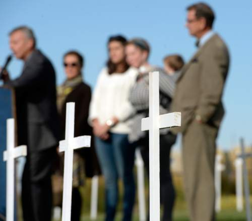 Al Hartmann  |  The Salt Lake Tribune Board members of Alliance for a Better Utah stand in a field of 361 crosses on the front lawn of the Utah State Capitol Thursday Oct. 21 to speak at a press conference.  Today marks 657 days since the Utah Legislature had the first opportunity to grant access to affordable healthcare for thousands of Utahns most in need. Better Utah estimates that as many as 361 Utahns (represented by the rows of crosses) have died because they don't have access to affordable healthcare.