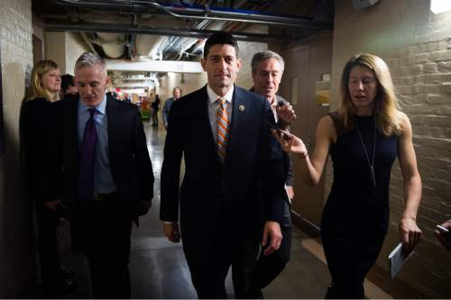 Rep. Paul Ryan, R-Wis., center, and Rep. Trey Gowdy, R-S.C., arrive  for a House GOP meeting on Capitol Hill in Washington, Friday, Oct. 9,  2015. The pressure is on Ryan to run for House speaker in the chaotic aftermath of Majority Leader Kevin McCarthy's sudden decision to abandon his campaign for the post.  (Doug Mills/ The New York Times via AP)