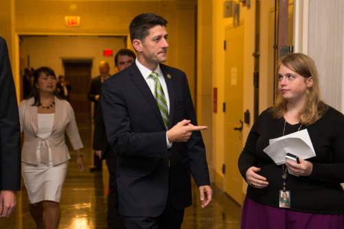 """FILE - In this Oct. 8, 2015 file photo, Rep. Paul Ryan, R- Wis. arrives for a meeting on Capitol Hill in Washington. Maybe Ryan doesn't feel like a character in the classic film """"The Godfather"""" weighing in an offer he can't refuse. But with Republican party elders practically begging him to become the next House Speaker, the pressure on him to seek the post is immense.  (AP Photo/Evan Vucci, File)"""