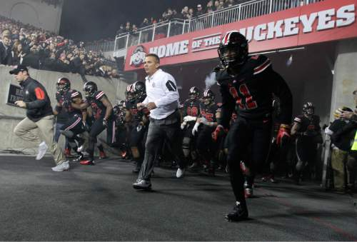 Ohio State head coach Urban Meyer leads his team on to the field before their NCAA college football game against Penn State, Saturday, Oct. 17, 2015, in Columbus, Ohio. (AP Photo/Jay LaPrete)