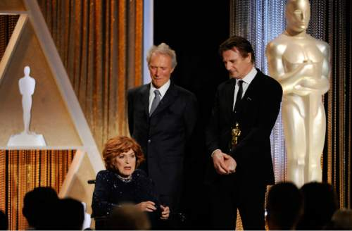 """FILE - This Nov. 8, 2014 file photo actress Maureen O'Hara accepts her Honorary Oscar onstage as presenters Clint Eastwood, center, and Liam Neeson look on during the 2014 Governors Awards in Los Angeles. Manager says Maureen O'Hara, star """"How Green Was My Valley"""" and other classics, has died. (Photo by Chris Pizzello/Invision/AP,File)"""