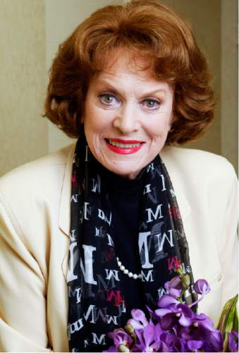 """FILE - In this March 9, 2004 file photo, actress Maureen O'Hara poses for a photo in the Bel Air Estates area of Los Angeles.  O'Hara,who appeared in such classic films as """"The Quiet Man"""" and How Green Was My Valley,"""" has died. Her manager says O'Hara died in her sleep Saturday, Oct. 24, 2015 at her home in Boise, Idaho.  (AP Photo/Damian Dovarganes)"""