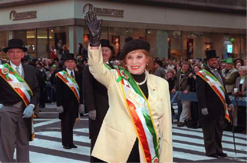 """FILE - In this March 17, 1999 file photo, St. Patrick's Day Parade Grand Marshal Maureen O'Hara waves to the people lined up along Fifth Avenue at the annual St. Patrick's Day Parade in New York.   O'Hara,who appeared in such classic films as """"The Quiet Man"""" and How Green Was My Valley,"""" has died. Her manager says O'Hara died in her sleep Saturday, Oct. 24, 2015 at her home in Boise, Idaho. (AP Photo/Ed Bailey)"""
