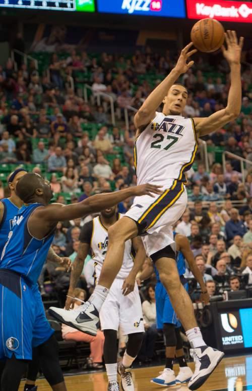 Rick Egan  |  The Salt Lake Tribune  Utah Jazz center Rudy Gobert (27) passes off the ball,  in NBA action in the final home game of the season at EnergySolutions Arena, Salt Lake City, Monday, April 13, 2015.