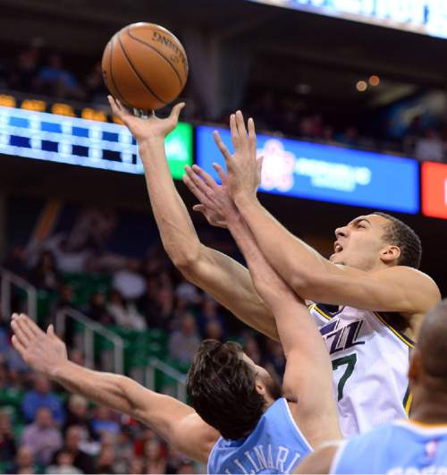 Steve Griffin  |  The Salt Lake Tribune  Utah Jazz center Rudy Gobert (27) powers his away to the basket as he shoots over Denver Nuggets forward Danilo Gallinari (8) during first half action in the Jazz versus Nuggets NBA game at EnergySolutions Arena in Salt Lake City, Wednesday, April 1, 2015.